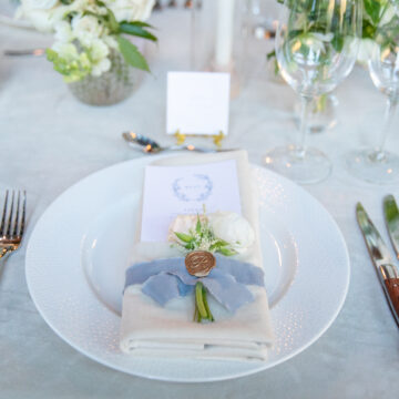 alex and kevin place settings at their wedding